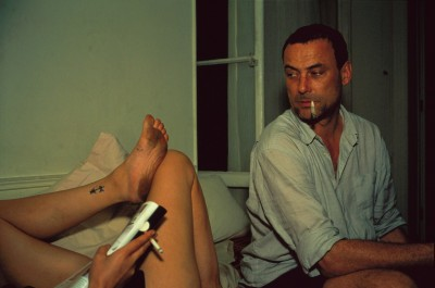 Bruno smoking a joint (with Valeries legs), Paris, 2001.jpg
